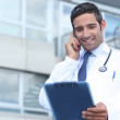 Young doctor stood outside hospital — Stock Photo #9289639