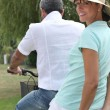 Man carrying woman on a bicycle — Stock Photo