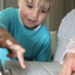 Stock Photo: Boy learning computer skills