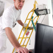 Painter checking instructions on Internet — Stock Photo #9289849