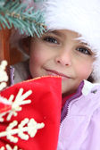 Young girl outside a winter cabin — Stock Photo