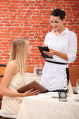 Waitress with customer — Stock Photo