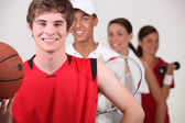 A row of athletes — Stock Photo