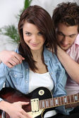 Young girl with electric guitar — Stock Photo