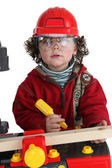 Child playing builder — Stock Photo