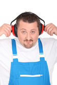 Working man with earmuffs — Stock Photo