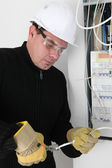 Man fixing fuse box — Stock Photo