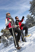 Couple snow-shoeing — Stock Photo