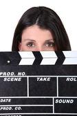 Film clapper tutan kadın — Stok fotoğraf