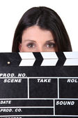 Woman holding movie clapper — Stok fotoğraf