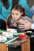 Couple and little girl having their house built — Stock Photo