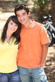 Couple with bikes in the background — Stock Photo