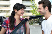Smiling couple going for a ride — Stock Photo