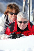 Middle-aged couple having fun on their skiing holiday — Stock Photo