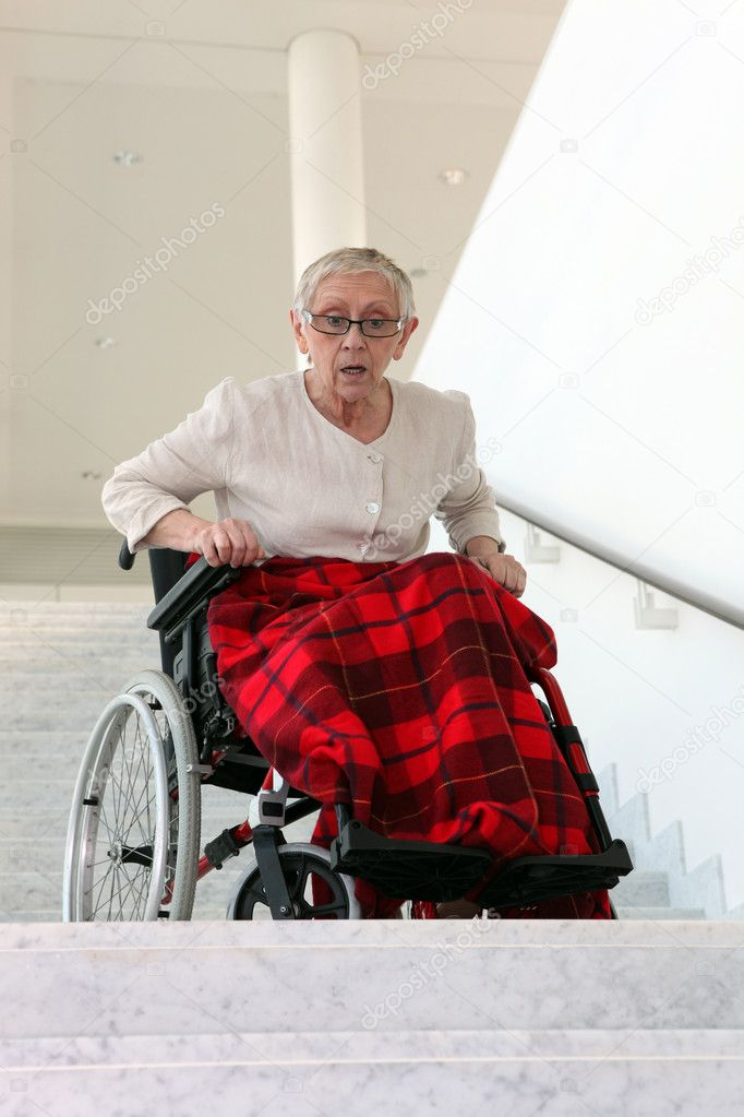 Disabled woman in front of stairs — Stock Photo #9287341