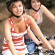 Two girls on a bicycle — Stock Photo