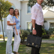 Couple visiting house for sale — Stock Photo #9290417
