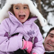 Father and daughter having fun in the snow — Stock Photo #9298366