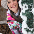 Woman behind snowy tree — Stock Photo #9298734