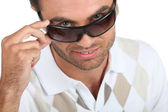 Portrait of young man wearing sunglasses — Stock Photo