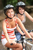 Two girls on a bicycle — Fotografia Stock