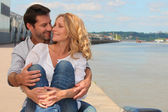 Couple embracing at the pier — Stock Photo