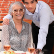 Grandson and grandmother in restaurant — Stock Photo