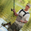 Oblique image of a fisherman on a river — Stock Photo #9300330