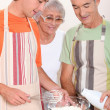 Grandparents and grandson in the kitchen — Stock Photo #9301309