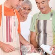Grandparents and grandson in the kitchen — Stock Photo