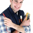 Electrician with a measurement tool — Stock Photo