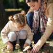 Mother and daughter picking mushrooms — Stock Photo