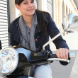 Woman on her motorcycle in the city — Stock Photo