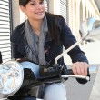 Stock Photo: Woman on her motorcycle in the city