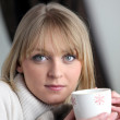 Woman drinking a hot drink — Stock Photo #9303784