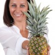 Stock Photo: Womwith whole pineapple