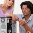 Man repairing PC for colleague — Stock Photo