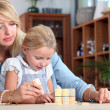 Mother playing with daughter at home — Stock Photo
