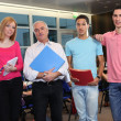 Teacher stood with university students — Stockfoto