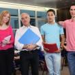 Teacher stood with university students — Stock Photo