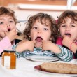 Playful kids celebrating birthday — Stock Photo #9305346