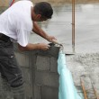 Builder laying foundations — Stock Photo