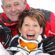 Stock Photo: Senior couple having a great time skiing
