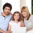 Family with a laptop — Stock Photo #9306969