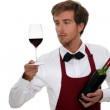 A wine waiter watching a red wine glass — Stock Photo