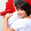 Couple painting in red — Stock Photo
