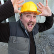 Alarmed construction worker - Stock Photo