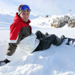 Stock Photo: Snowboarder sat taking a little break