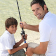 Little boy fishing with his dad — Stock Photo #9307672