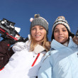 Two girls with skis — Stock Photo